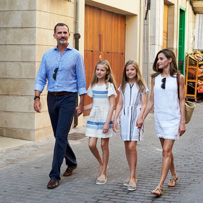 During their summer trip to Mallorca, the sisters coordinated in stripes. Both girls wore their hair down and with an extreme part. They also opted for the same shoes on their August stroll.