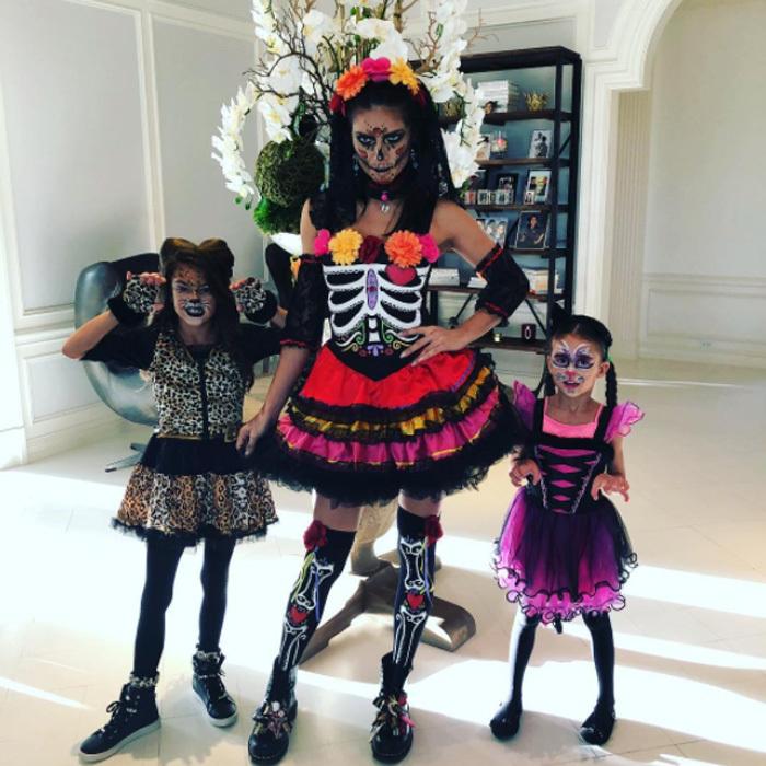 Adriana Lima donned full face paint and dressed up in honor of Dia de los Muertos. Her daughters Valentina and Sienna also took advantange and wore full makeup for their own outfits.