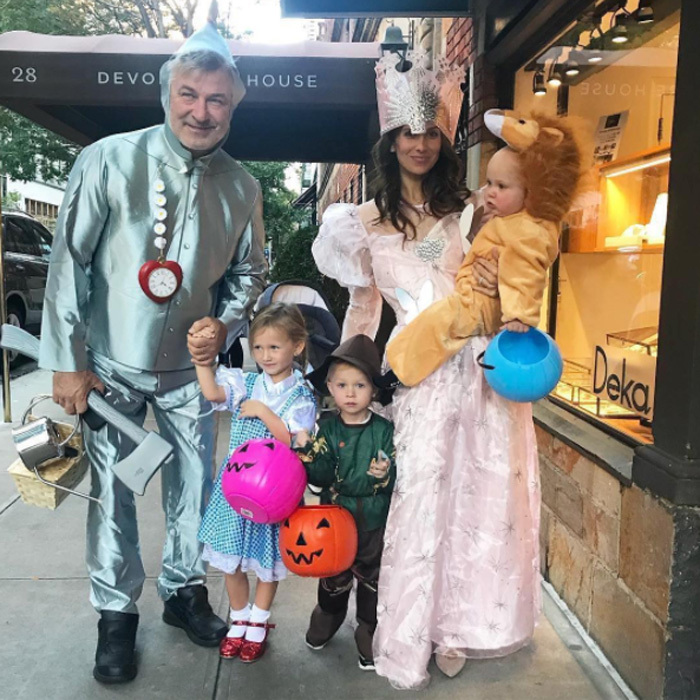 The Baldwin family did the <i>Wizard of Oz</i>. The family-of-five all dressed in character as they went trick-or-treating in NYC. Alec was a good sport as the Tin Man with Hilaria dressing as Glinda the Good Witch. Their adorable kids acted as Dorothy, the Scarecrow and the Cowardly Lion.