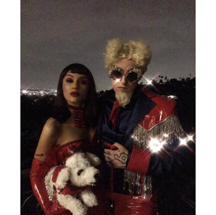 Ariana Grande and Mac Miller dressed as Katinka and Mugatu from <i>Zoolander</i> for their Halloween. The couple perfectly coordinated with Ariana sporting a black wig with bangs.