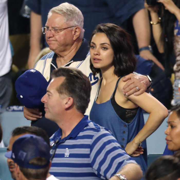 Mila Kunis watched game two with her dad Mark in Los Angeles. With the temperatures in the high-90s, the actress wore a blue tank to keep cool.