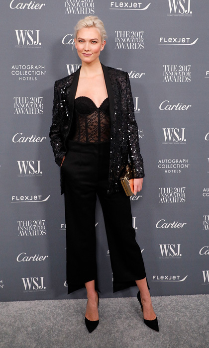 Karlie Kloss showed off her men-inspired look on the WSJ Magazine Innovator Awards carpet. The supermodel wore her blonde hair back and added sparkle to her look with a sequined blazer over a lace corset.