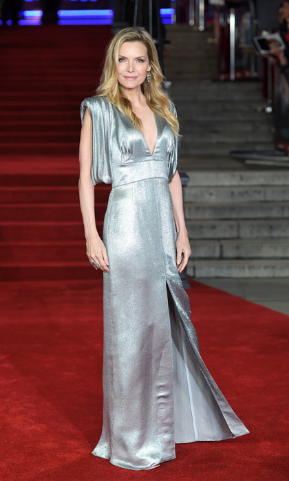 Michelle Pfeiffer was certainly no devil in Prada at the <i>Murder on the Orient Express</i> red carpet in London. The actress stunned in this silver metallic gown with a plunging neckline and high slit.