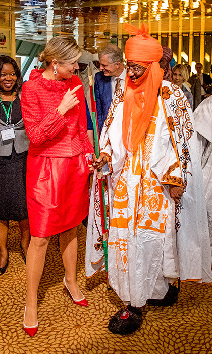 On tour in Nigeria, Queen Maxima of the Netherlands made a colorful statement in bright red as she met with Emir of Kano Mallam Emir Muhammadu Sunusi II at the Enhancing Financial Innovation and Access event, 'The Role of the Government'. The Dutch monarch's wife gave a speech at the conference, which was held on November 2 in the country's captial, Abuja.