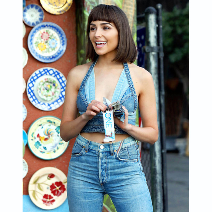 Olivia Culpo tested out a new look with a bob and bangs in L.A. The former beauty queen also snacked on a One Bar while running errands around town.