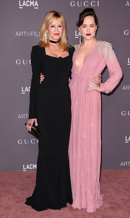 Dakota Johnson and her mom Melanie Griffith were sure to turn heads on the LACMA Art + Film Gala red carpet. The <i>Fifty Shades Freed</i> star stunned in a pink Gucci gown with silver embellishments and a plunging neck while the 60-year-old opted for a figure-hugging black gown. 