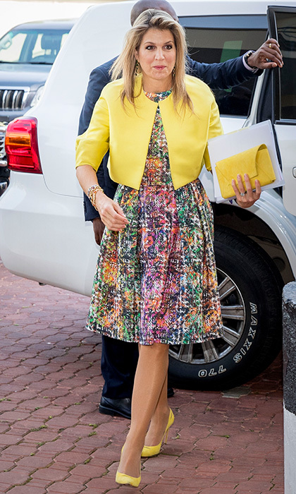 Queen Maxima of the Netherlands famously loves cheery hues, and for her visit to Nigeria she made sure to pack some of her favorites! On November 1, the monarch's wife wore a bright print Natan dress with even brighter accessories – a clutch and yellow pumps that perfectly matched her cropped jacket – for a visit to the local UN office. 