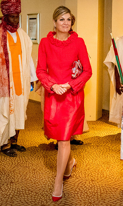 Another bright creation from one of the Dutch Queen's favorites, Natan!  Maxima wore this ensemble on day 3 of her Nigeria visit, as she attended the Enhancing Financial Innovation and Access conference, where she was set to speak. 