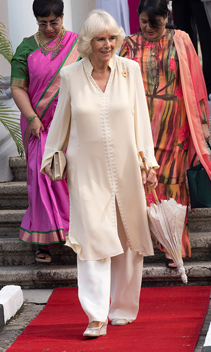 Traveling in Southeast Asia, Camilla, Duchess of Cornwall beat the heat in a silk caftan and trousers on November 7. The royal was with husband Prince Charles visiting St George & Otilde's Church in Penang, Malaysia. 