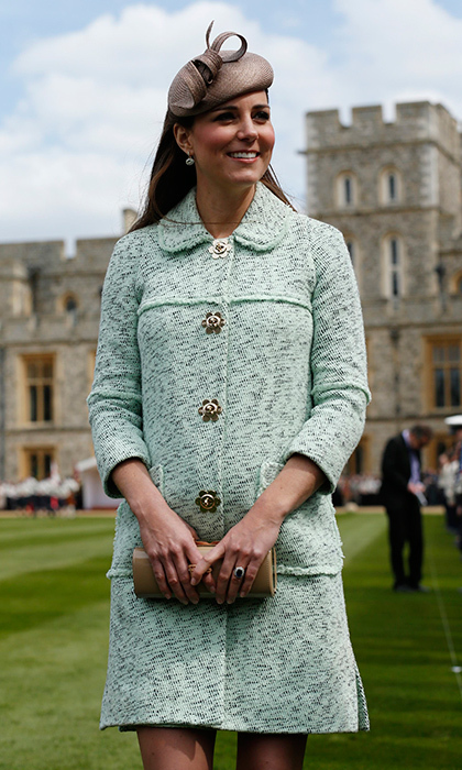Buttoned up: The stylish royal attended the Queen's Scout Parade at Windsor Castle on April 21, 2013 wearing a fresh spring look – a mint green Mulberry coat and a Whiteley hat. 