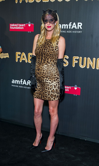 Fierce feline! Lily Grace's mom dressed up in a figure-hugging leopard dress for the amfAR & The Naked Heart Foundation Fabulous Fund Fair on October 28. She paired the look with Louboutin heels.