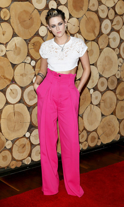 Kristen Stewart had a bright idea wearing high-waisted hot pink pants with a white cropped t-shirt to the premiere of  Starlight Studios And Refinery29's <i>Come Swim</i> in L.A.