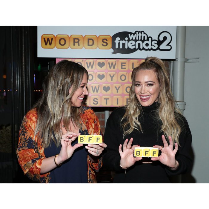 "Hilary and Haylie Duff are more than just sisters - they're best friends too! The cute pair were all smiles as they hosted the Words With Friends 2 launch party at Norah Restaurant in West Hollywood on November 9. The famous siblings, who are huge friends of the game, seemed to enjoy the evening, munching on ""BFF"" sugar cookies and laughing with fellow guests. Other celebrity attendees included: Erin Foster, Sarah Foster, and Alessandra Ambrosio.