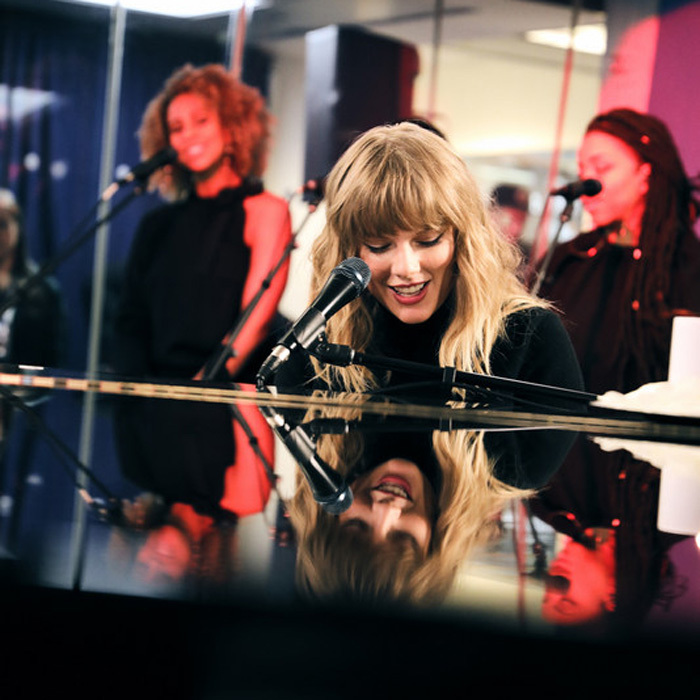 Taylor Swift took a break from her <i>Saturday Night Live</i> rehearsals to drop by SiriusXM to perform an acoustic performance from her new album <i>Reputation</i>. While there, she also spoke about Tom Petty and mentioned her favorite song of the late singer's is <i>American Girl</i>.