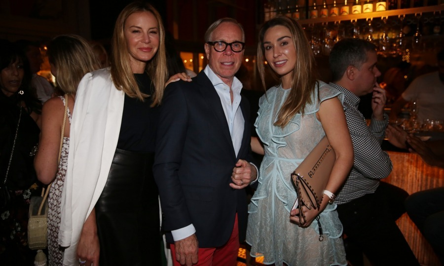 Wearing his signature colors, Tommy Hilfiger hosted a holiday kickoff celebration at DÔA in Miami Beach on November 8. Arriving with his wife Dee Hilfiger (left), Tommy admired the restaurants newly designed space and mingled before sitting for dinner with his entourage of 10 for an exclusive first taste of the restaurant's new fall menu.