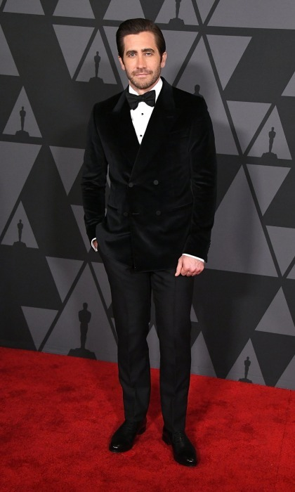 Also dressed in cozy black velvet attire was Jake Gyllenhaal. The 36-year-old Oscar-nominee opted to mix up his usual suit-style by wearing a softer jacket and bowtie. Jake, who has been working the circuit for his film <i>Stronger</i>, seemed happy to be at the celebratory evening as he stopped for photos.