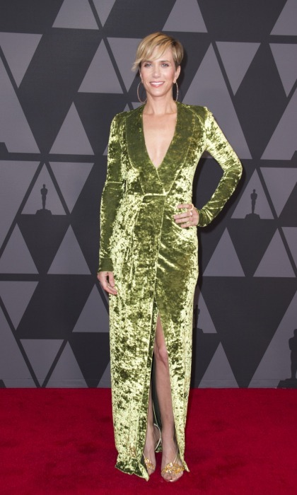 Kristen Wiig kept the velvet trend going, flaunting her figure in a smooth green Galvan number. The funny lady accessorized with Nicholas Kirkwood heels, Djula hoops, and Atelier Swarovski rings.