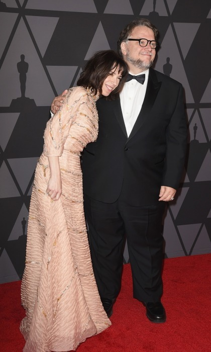 Sally Hawkins cozied up to her director and pal Guillermo del Toro as they walked into the lavish ceremony together. The 41-year-old actress wore a frilled dress that matched her skin tone, save for the shimmering silver and gold stripes that were wrapped across it.