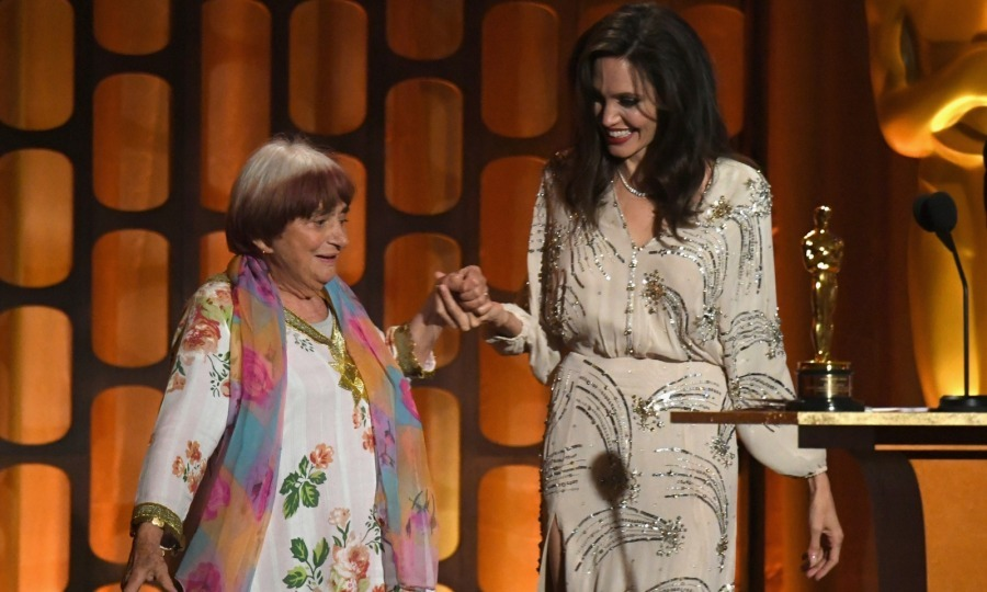 "Dance revolution! During a heartfelt speech, Angelina Jolie praised French director Agnes Varda, who was an honoree at the 2017 Governors Awards. While the star may have expected a hug from Agnes afterwards, she probably didn't ever think they'd do a dance! However, that's exactly what they did. The 89-year-old Varda talent broke out her moves after accepting the honorary Oscar in what was a highlight of the evening. ""Tonight. I feel like dancing,"" Varda said to the crowd. ""The dance of cinema."" Angelina, who lived up to her stylish reputation in a bedazzled beige Elisabetta Franchi dress, was game for the impromptu moment, smiling as the pair got jiggy with it. 
