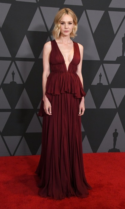 Miss Scarlett! Carey Mulligan turned heads in a deep red Giambattista Valli Couture dress. The design featured a plunging neckline and frilled waist flourish. Her short locks perfectly framed her face as she headed down the carpet.