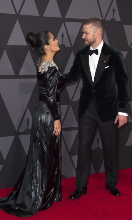 "Justin Timberlake seemed to take a page from Jake's fashion book, exchanging his ""suit and tie"" for a velvet jacket and bowtie. In a fun carpet moment, the superstar caught up with Salma Hayek. The pair hugged and kissed, before heading into the event.