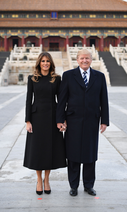 The first couple arrived in Beijing on November 8. Melania looked sophisticated wearing an Alexander McQueen coat, while styling her hair down with her signature blowout. The first lady and President Trump held hands as they posed for a photo in the Forbidden City.