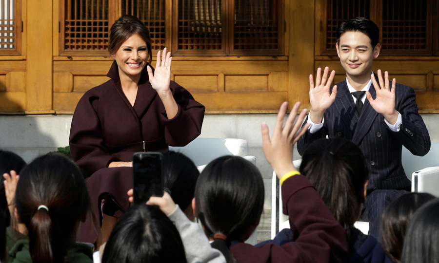 "A beaming Melania joined Choi Min-ho, a member of the South Korean boy band Shinee, at the ""Girls Play 2!"" Initiative held at the US Ambassador's Residence in Seoul. The pair waved to South Korean middle school students during the program, which is an Olympic public diplomacy outreach campaign.