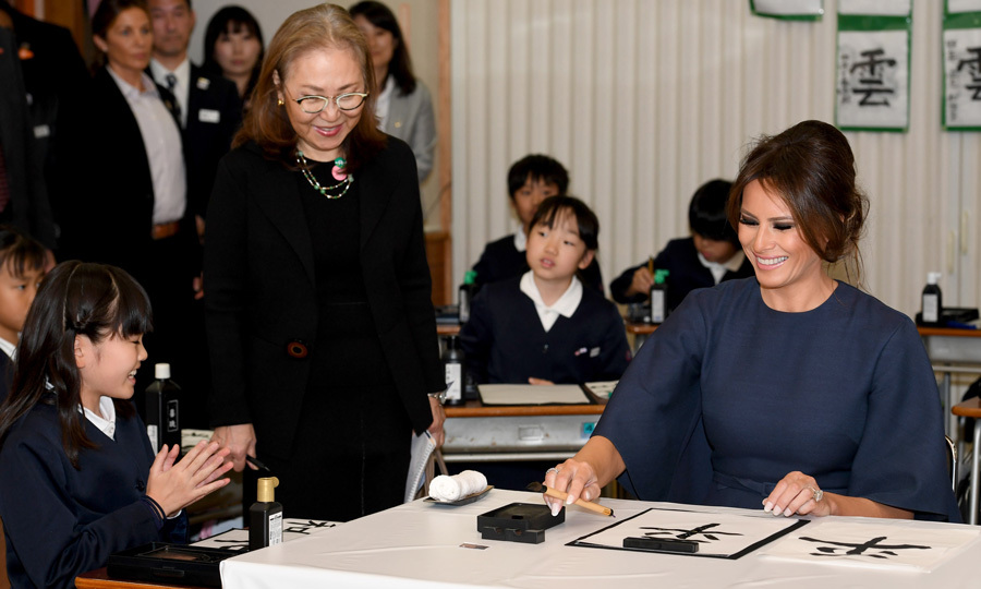 "During the outing to the school, the mom-of-one visited a fourth grade classroom, where she admired their Japanese calligraphy. ""Beautiful characters,"" she said. When asked if she would like to try, she replied, ""Fantastic, would love to.""
