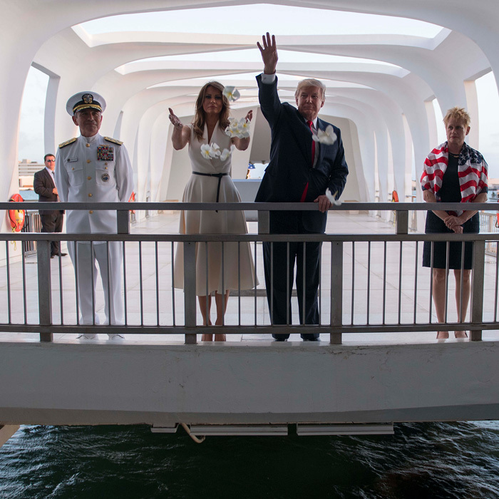 En route to Asia, the first couple paid a visit to Honolulu, Hawaii on November 3. The first lady, dressed in a creme Dior number, and president threw flowers while visiting the USS Arizona Memorial at Pearl Harbor.