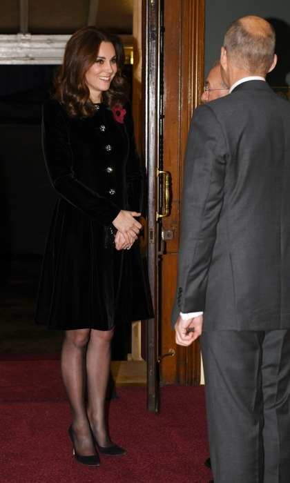 The Duchess of Cambridge attended the annual Royal Festival of Remembrance at the Royal Albert Hall in London on November 11 with Queen Elizabeth. Kate wore a simple black velvet design by Princess Diana favorite Catherine Walker, and a red poppy in honor of Britain's war heroes. The red poppy is worn to symbolize the poppies which grew on French and Belgian battlefields during World War I.