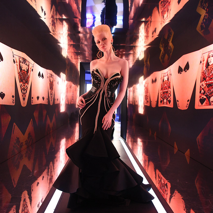Another of the calendar's gorgeous stars, South African model and lawyer Thando Hopa, struck a pose at the party where glamour was definitely in the cards. 