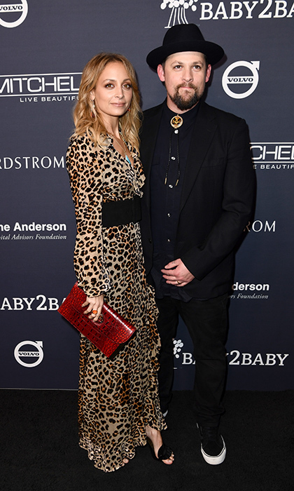 Cool mom Nicole Richie took a walk on the wild side in an animal print gown alongside her rock star husband Joel Madden. 