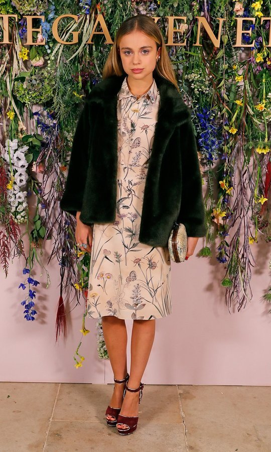 One of today's most fashionable royals, Lady Amelia Windsor demonstrated how to do fall layers in style. The British beauty wore a peach floral print dress with a furry dark green coat to the Bottega Veneta 'Hand of the Artisan' cocktail dinner at Chiswick House and Gardens in London on November 9. 