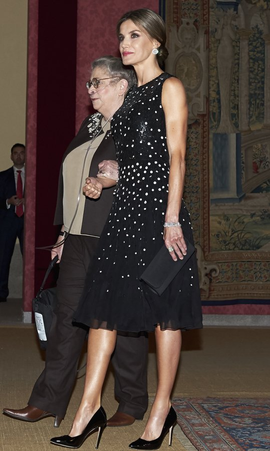 Queen Letizia looked perfectly polished, sweeping her hair up into an elegant bun for a reception at El Pardo Palace in Madrid. The royal mom-of-two, joined by Israel's First Lady Nechama Rivlin, looked impeccably chic wearing a sequin silk midi dress by Carolina Herrera.