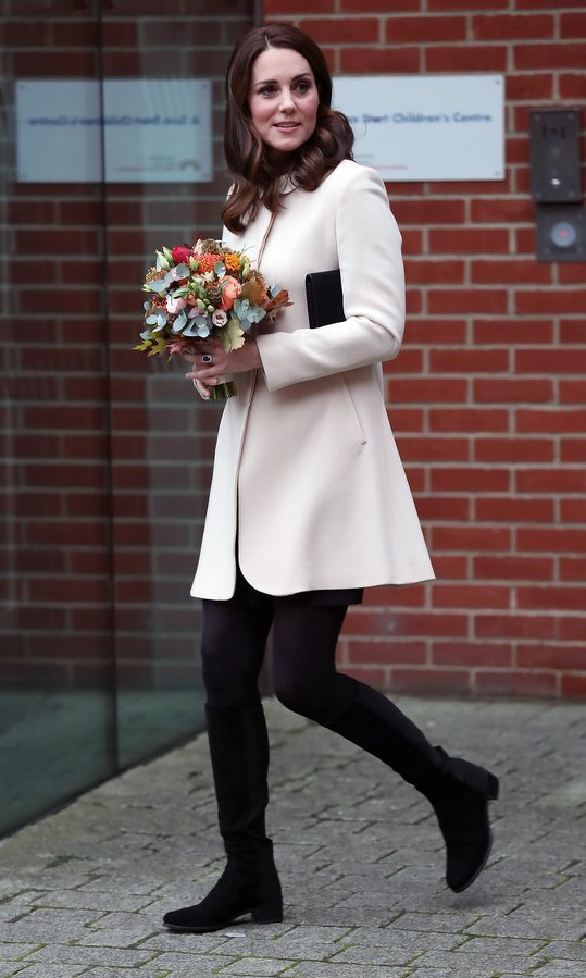 Currently expecting her third child, Kate Middleton recycled her cream coat by GOAT for an outing to the Hornsey Road Children's Centre on November 14. The royal wore tights and suede low-heeled boots for the visit, where she met with fellow expectant moms. 
