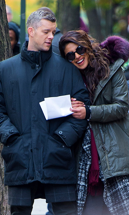 Co-stars Russell Tovey and Priyanka Chopra stayed warm as they shared a laugh on the midtown set of <I>Quantico</I> on November 14. The pair are currently shooting episodes for the show's third season on ABC.
