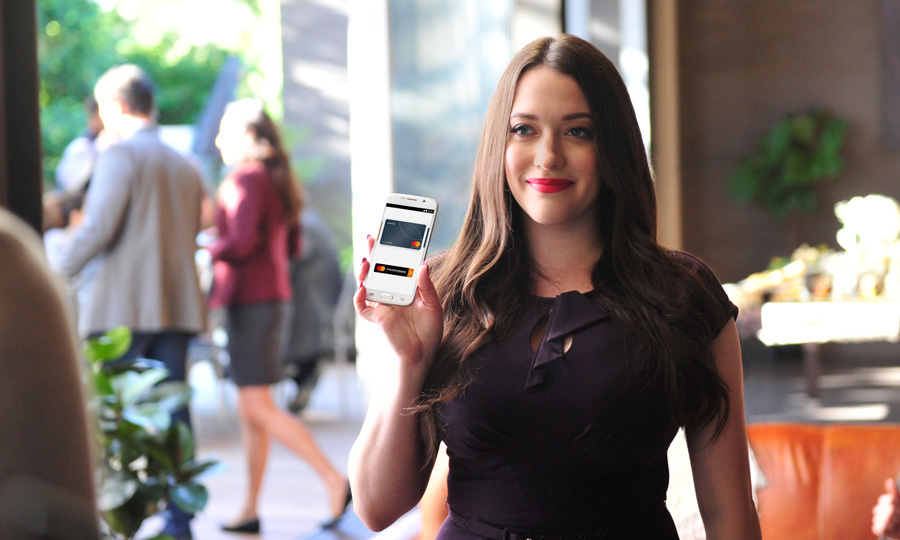 Kat Dennings showed how easy it is to use the Masterpass on set of her Mastercard commercial in L.A. 