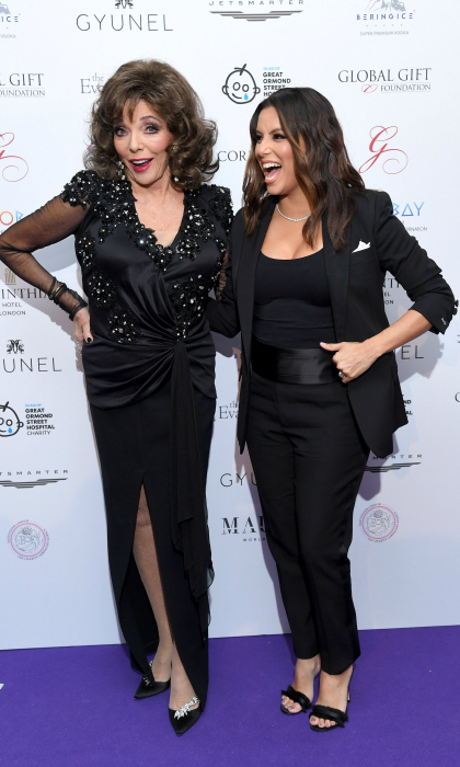 "Dame Joan Collins and Eva Longoria met up at The Global Gift gala held at the Corinthia Hotel on November 18 in London. The pair stunned in black as they walked seemed to have a blast on the carpet together. ""Arrived in London for the @globalgiftgala at @corinthiaLondon to raise funds for @greatormondst @GlobalGiftFound with @mariarbravo #GGGLondon17,"" Eva posted on Instagram ahead of the gala.