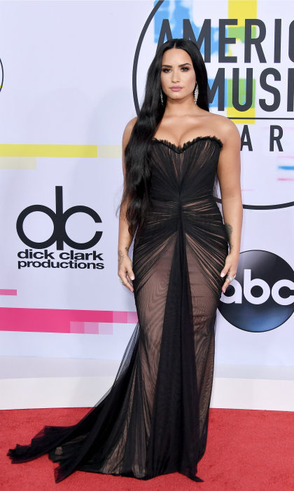 "Demi Lovato brought the glam to the AMA's, opting for a gorgeous Ester Abner gown, Stuart Weitzman shoes, and Gismondi jewelry. For her date, the 25-year-old singer invited Virginia Representative Danica Roem, who was just elected as the first openly transgender legislator in the United States. ""Demi Lovato and Danica Roem are two strong and inspirational women who embody the need for all Americans to stand together united and to take action today against any form of discrimination and oppression,"" GLAAD President and CEO Sarah Kate Ellis said in a statement. ""Danica Roem is a trailblazer whose win in Virginia showcased both how young people and marginalized communities can impact voting results and how every American deserves an opportunity to work hard and achieve their dreams,"" she added. ""Demi Lovato continues her legacy of raising the bar for entertaining audiences around the world and for spotlighting social issues that need the most attention.""