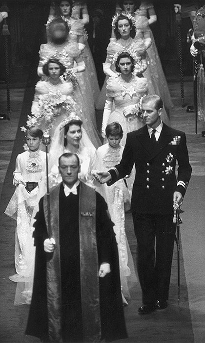 The bride and groom are seen walking down the aisle followed by their eight bridesmaids and two page boys during the ceremony, which was officiated by both the Archbishop of Canterbury and the Archbishop of York. 
