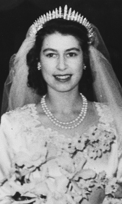 The bride's wedding look, which included a double-strand royal heirloom pearl necklace, would not have been complete without a stunning tiara. Princess Elizabeth wore Queen Mary's Fringe Tiara, consisting of 47 diamond bars using stones taken from a necklace Queen Mary had been given by Queen Victoria.