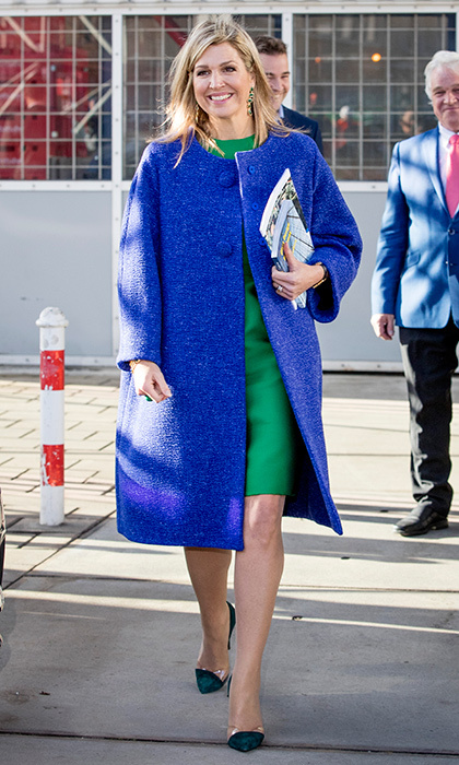 Queen Maxima of the Netherlands had a bright smile as she visited family company Octatube on Entrepreneur's Day on November 17 in Delft. Also bright was the Dutch royal's color block outfit: a green silk dress and blue jacket with transparent cap toe pumps. 