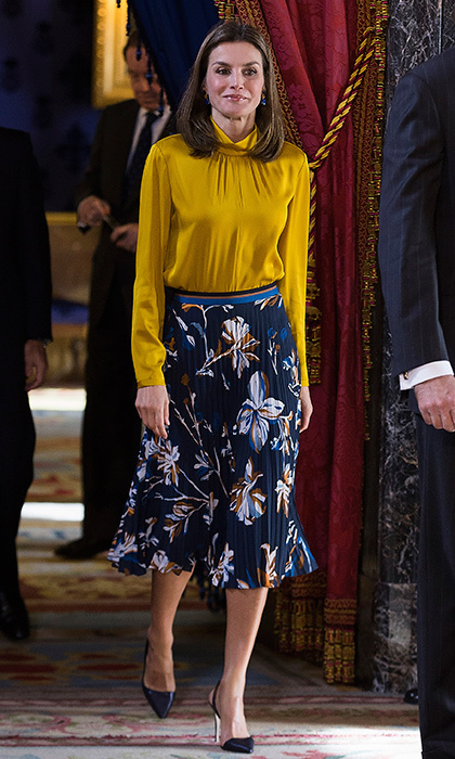Queen Letizia of Spain looked to one of her favorites as she greeted Palestinian President Mahmoud Abbas at the Royal Palace in Madrid on November 20. The royal wore a mustard blouse and floral print pleated skirt by BOSS by Hugo Boss. 