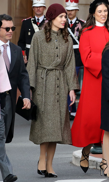 Fashion darling Charlotte Casiraghi – daughter of Princess Caroline – channeled the 1920s in a brown coat, patent leather shoes and a burgundy cloche hat embellished with a large flower detail. She also wore her hair in long ringlets, adding even more vintage allure to the look. 