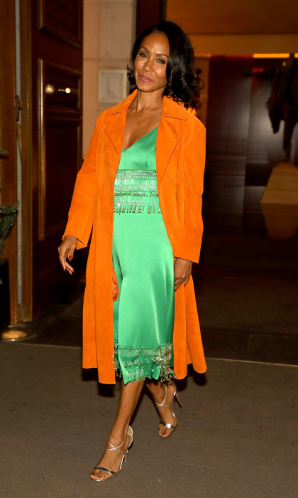 It may be November, but Jada Pinkett Smith kept the Halloween-spirit alive in her green and orange ensemble. The <i>Girls Trip</i> actress wore a green Prada satin dress with an orange coat to the Paris premiere of the film.
