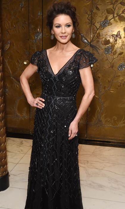 Catherine Zeta-Jones showed off her toned arms in a black gown with silver beading during the 2017 Walpole British Luxury Awards. The <i>Cocaine Godmother</i> actress kept her hair pulled back with drop earrings.