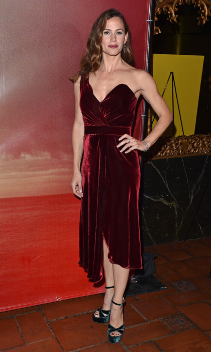 Jennifer Garner was on trend in velvet for the premiere of <i>The Tribes of Palos Verdes</i> in L.A. The mom-of-three wore a one-shouldered cranberry dress and kept her hair in waves and off to one side.