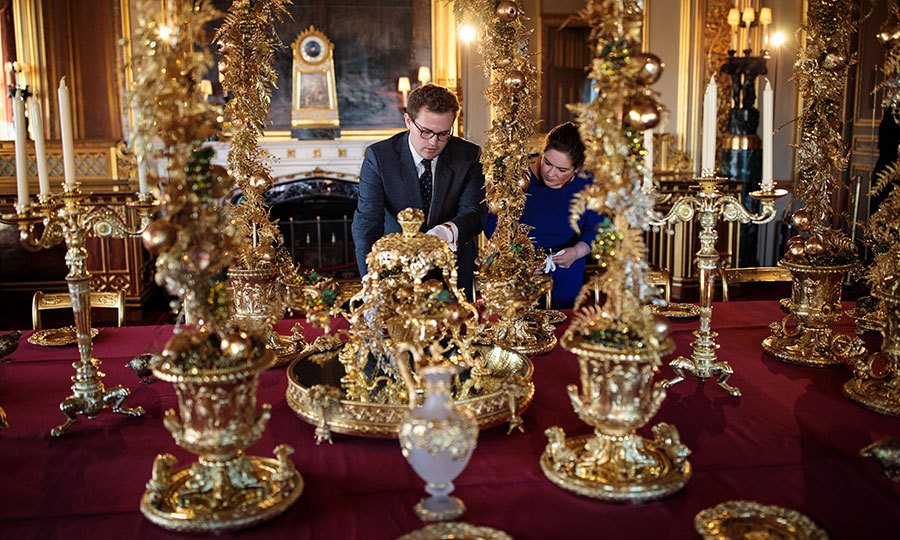 At Windsor Castle, Queen Elizabeth's weekend and Easter home, palace workers decorated the tables in the State Dining Room for the Christmas season. The scene is set with silver-gilt pieces from the Grand Service. 