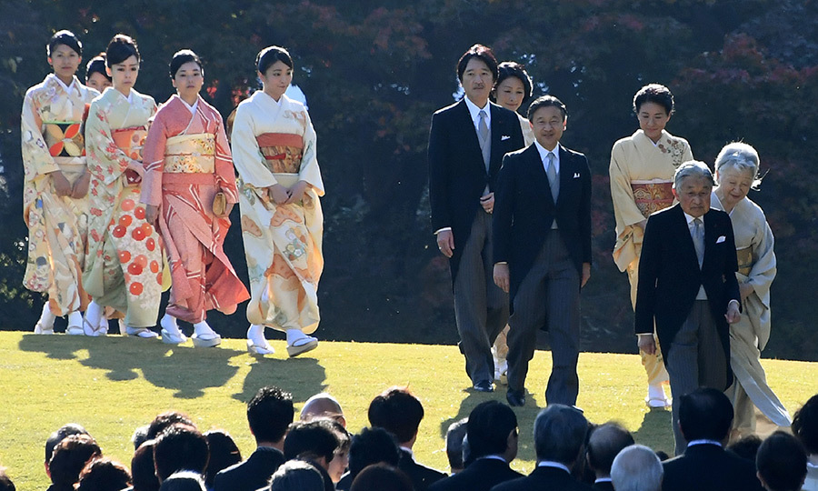 Emperor Akihito and Empress Michiko, far right, lead the Japanese royal family during an Imperial garden party at Akasaka Palace  in Tokyo. Joining the occasion were Prince Naruhito, behind his father the Emperor, with wife Crown Princess Masako, followed by Prince Akishino and Princess Kiko. Behind them are Princesses Mako, Akiko, Yoko, Tsuguko and Ayako. 