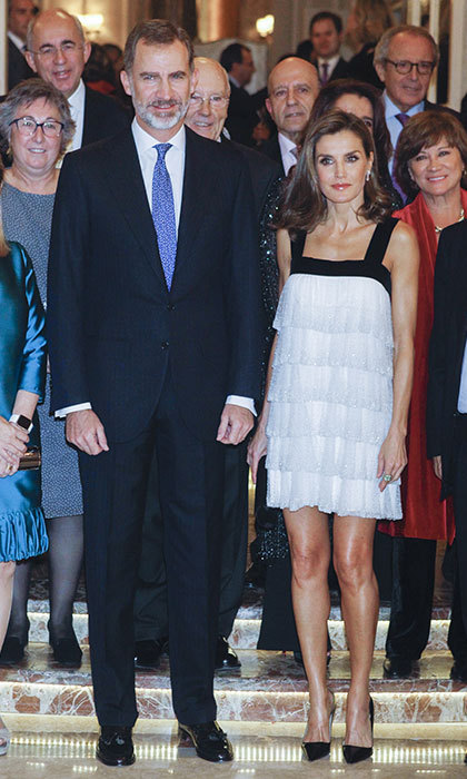 All eyes were on Queen Letizia when she stepped out in Madrid on 23 November to attend the journalist awards ceremony Francisco Cerecedo, with King Felipe. The royal looked gorgeous in a monochrome flapper-style number, which showed off her toned legs. Letizia's dress – which was embellished with glittery sequins – featured thick black velvet straps, and was identified by website Queen Letizia style as a 2008 Teresa Helbig design. The dress looked lovely teamed with a pair of Prada Saffiano Leather Point Toe Pumps, while a black clutch and silver drop earrings completed her look.